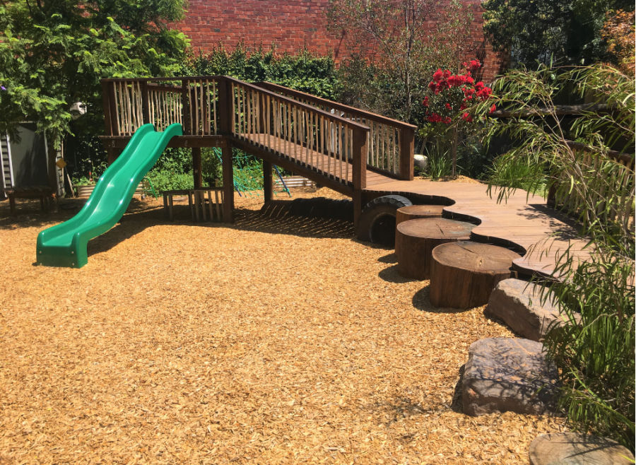Wooden elements and textures add to the fun of the traditional slide (eek!)
